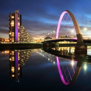 The Clyde Arc Bridge reflecting on the River Clyde during evening twilight